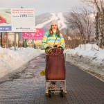 A mother walking with her baby in the center of Yuzhno-Sakhalinsk.