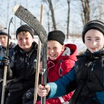 Russian children taking a break from playing hockey.
