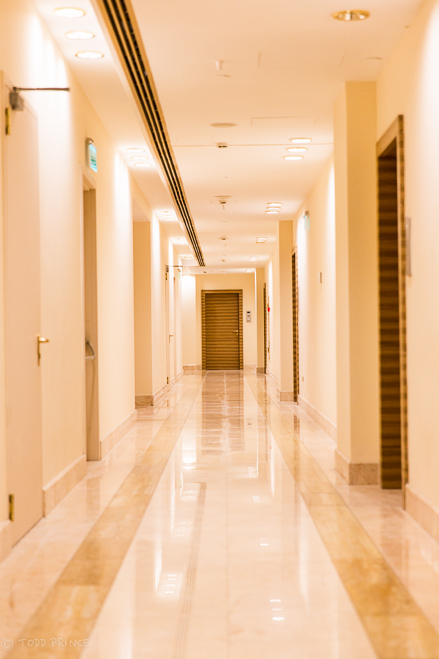 The empty corridor on the 43rd floor of the Empire skyscraper, where the hostel is located.