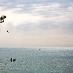 A man parasailing over the Sochi waters.
