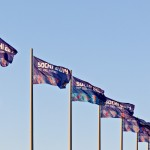 Sochi 2014 flags waving in the wind during a summer sunset.
