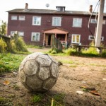 A beat-up soccer ball in front of a home on Solovki.