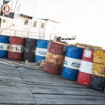 Oil barrels in front of a boat on Solovki.