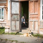 An 87-year old woman looking out the entrance of her home on Solovki.