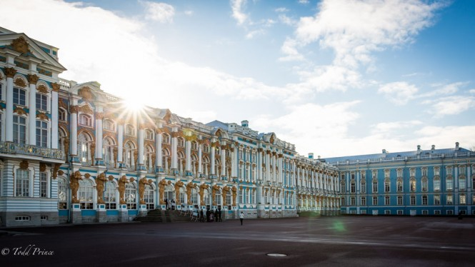 The sun rising over the Catherine Palace, creating sun flare.