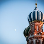 The moon looks down on St. Basil's Cathedral.