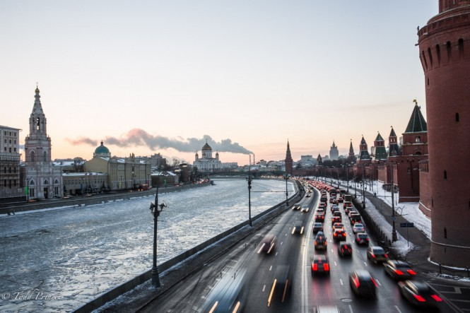 Steam rises from a power plant in the distance as traffic builds by the Kremlin.