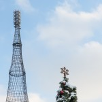 The Soviet-era Shukov radio tower rises above a Christmas tree near central Moscow.