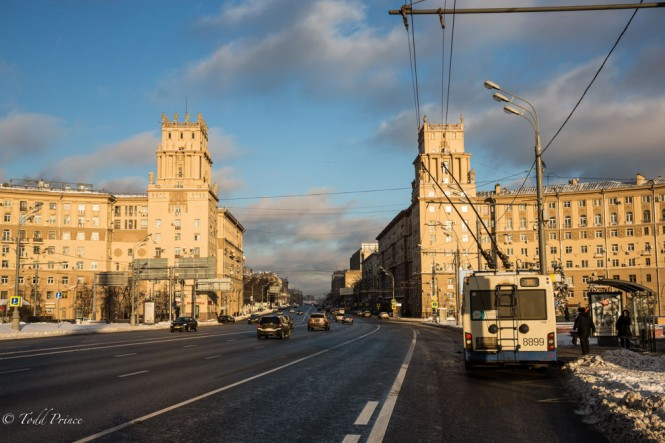 Sun-lit Stalin buildings welcoming drivers as they approach the Moscow city center.