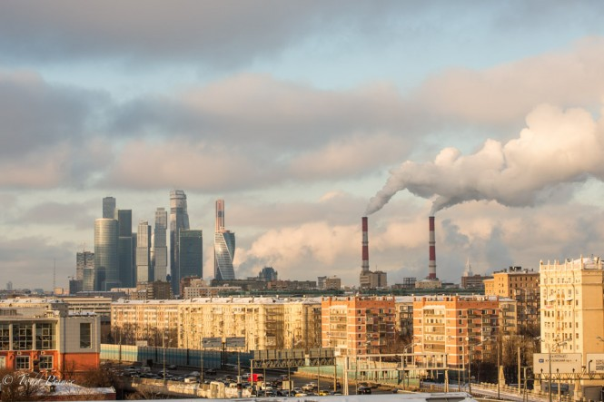 A power station releases steam near the Moscow Financial District.