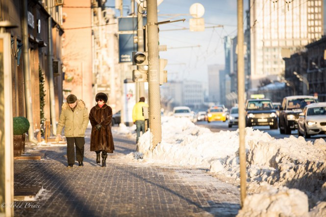 A Russian woman dressed in fur walking down Leninsky Prospect on a cold but sunny Moscow winter day.