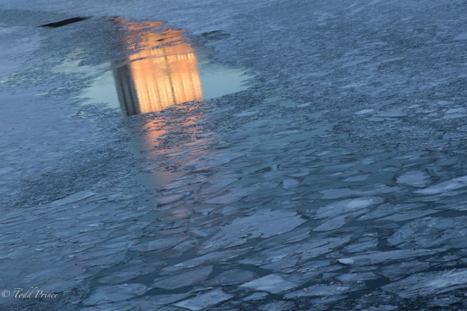 A reflection of the Russian Academy of Science building in the frozen Moscow River.