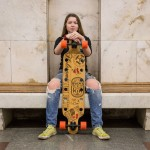 Katya, 14, was sitting with her long board in the Moscow metro. She said she first stepped on a skateboard when she was five.