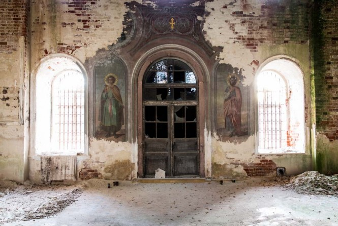 The inside an of an abandoned church in Bultiki in Vladimir region. Few of the paintings on the walls are visible.