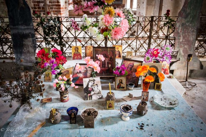 Russians still leave flowers and candles in this abandoned church.