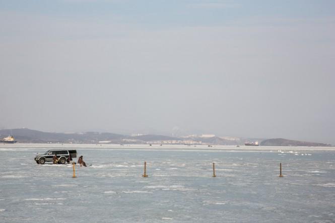 A man ice finishing in the sea off Vladivostok.