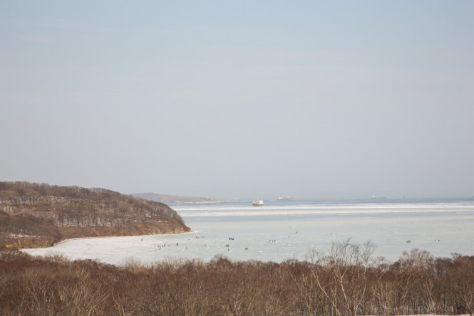 The little black dots on the ice are Russians ice fishing.
