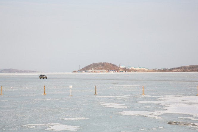 Driving over the ice in the sea off Vladivostok.