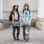 Lika and Lera were both wearing panama hats while carrying their skateboards along Nevsky Prospect.